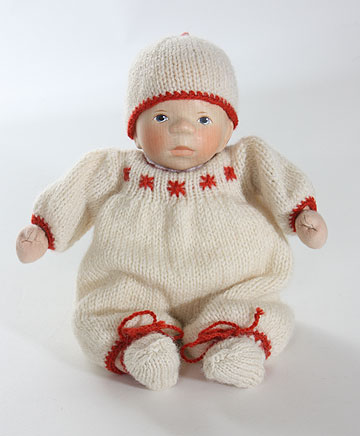 Baby In Cream With Red Trim M353 by Elisabeth Pongratz