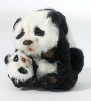 Tickles Panda With Cub