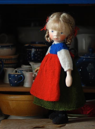 Blond Girl In Knit With Red Apron H348 by Elisabeth Pongratz