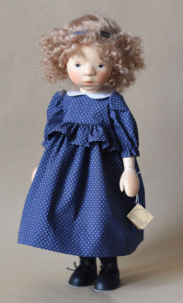 Blond Girl In Dark Blue Polka Dot Dress H366