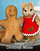 R. John Wright's Ginger The Christmas Mouse with gingerbread cookie