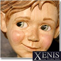 The Artists Of Xenis carve a face